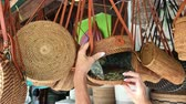 handbag : Woman choosing rattan eco bags in the art shop on Bali island, Indonesia. Woman stylish eco bag.