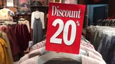 ruházat : Discount sign plate in the store. Shopping mall. 4K footage. Retail, sale, market.
