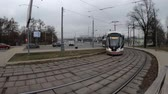 tram : MOSCOW, RUSSIA - NOVEMBER 27, 2019: Tram rides by rails during cloudy day. VDNKh station.