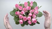 womens : Bouquet of roses on the table.