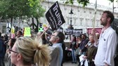 London, 28th September 2017:- Protesters gather in Whitehall, opposite Downing Street, to protest the growing tensions between North Korea and the USA Stock Footage