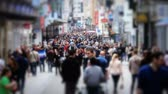 people : v57. Slow motion city pedestrian traffic shot on a busy Brussels shopping street using a tilt shift effect and added color correction. Stock Footage