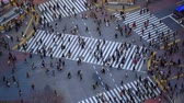 v60. City pedestrian traffic of people crossing the famous Shibuya intersection in Tokyo.