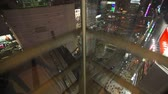 elevador : Elevator ride up with great view of famous Shibuya District at night on January 26th 2013.