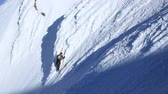 v1. Clip of mountain climber climbing up snow face of Mt Hood.