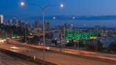 vibrante : v25. Panning clip of Seattle I-5 traffic time lapse with cityscape in background.