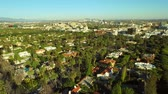 Los Angeles Aerial Beverly Hills v56 Low flying turning aerial over Beverly Hills neighborhood with 360 degree views.