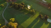 Los Angeles Aerial Golf Course v68 Turning vertical view aerial over golf course durning sunset. Stock Footage