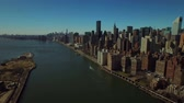 new york city : New York City Aerial v47 Low flying over Queensboro Bridge panning right with view of Midtown East Manhattan cityscape. Stock Footage