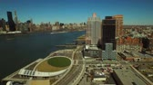 upper east side : New York City Aerial v62 Low flying backwards over Hunters Point panning left with views of Long Island City and Manhattan cityscapes. Stock Footage