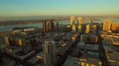 San Diego Aerial v30 Side view flying low over downtown at sunrise.