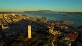 upscale : San Francisco Aerial v31 Lowering over Telegraph Hill with bay views at sunrise. Stock Footage