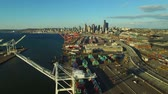 berendezés : Seattle Aerial v9 Flying low over large shipyard ports towards citycenter.