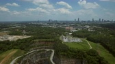Atlanta Aerial v56 Flying backwards over Bellwood Quarry and Westside Reservoir Park with cityscape views. Stock Footage