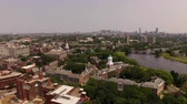 dorm : Boston Aerial v100 Flying low over Harvard campus panning right with cityscape views.