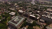 dorm : Boston Aerial v109 Flying low backwards over Harvard campus panning up.
