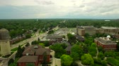 dorm : Ypsilanti Aerial v1 Flying low over University campus panning left. Stock Footage