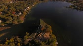 close up : Bloomfield Aerial v10 Flying over lake houses panning up. Stock Footage
