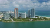 dodge : Miami Aerial v56 Flying low over Fisher Island panning with South Beach and cityscape views. Stock Footage