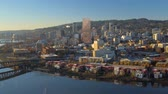 willamette : Portland Aerial v69 Flying low backwards over eastside panning with cityscape bridge views at sunrise. Stock Footage