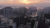 wong chuk hang : Hong Kong Aerial v32 Flying over Wong Chuk Hang city area at sunset.