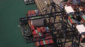 exportação : Hong Kong Aerial v18 Flying low over large cargo ship being loaded at shipyard terminal.