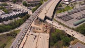 connector : Atlanta Aerial v284 Flying low backwards panning up from freeway bridge collapse with cityscape views 417