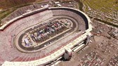спидвей : Bristol TN Aerial v15 Birdseye view flying around motor speedway during Nascar race 416 Стоковые видеозаписи