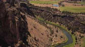 hiking trail : Oregon Aerial v7 Birdseye view flying low over Smith Rocks area Stock Footage