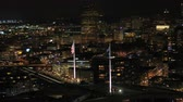 fremont : Portland Aerial v94 Closeup shot of flying around Fremont Bridge flags with cityscape views at night Stock Footage
