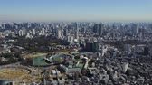 government district : Japan Tokyo Aerial v3 Flying over Yoyogi park panning with cityscape views 217