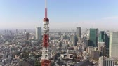 minato : Japan Tokyo Aerial v34 Flying low around Tokyo tower with cityscape views