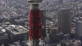 minato : Japan Tokyo Aerial v36 Closeup flying low around Tokyo tower with cityscape views