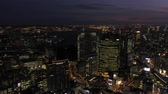 minato : Japan Tokyo Aerial v48 Flying low backwards over downtown Chuo area cityscape views night 217 Stock Footage