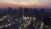 government district : Japan Tokyo Aerial v66 Flying low around famous Shinjuku area panning at dusk 217