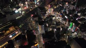 ilham vermek : Japan Tokyo Aerial v74 Birdseye view flying low over famous Shinjuku area panning down night 217 Stok Video