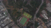 tilted : Hong Kong Aerial v62 Flying over Kowllon Walled City Park looking down vertically