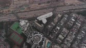 tilted : Hong Kong Aerial v61 Flying over Kowloon City looking down vertically panning