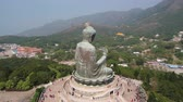 enlightenment : Hong Kong Aerial v90 Flying low around Tian Tan Buddha