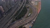 tilted : Hong Kong Aerial v180 Birdseye view flying around Western Harbour Crossing tunnel entrance