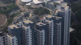 tilted : Hong Kong Aerial v186 Closeup birdseye view flying low around condominium complex Stock Footage