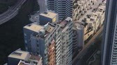 tilted : Hong Kong Aerial v187 Closeup birdseye view flying low around condominium complex