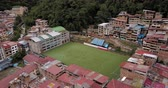 birdseye : Aguas Calientes Peru Aerial v3 Flying low around soccer game and field in town