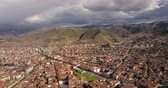 szomszédság : Cusco Peru Aerial v1 Flying low over downtown panning