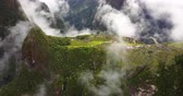 hillside : Machu Picchu Peru Aerial v6 Birdseye view flying over ancient ruins
