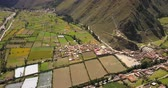 hillside : Ollantaytambo Peru Aerial v4 Flying over small town panning