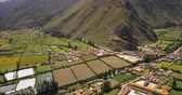 hillside : Ollantaytambo Peru Aerial v3 Flying low over small town panning Stock Footage