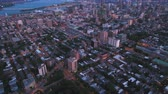 borough : Montreal Quebec Aerial v23 Flying over downtown at dusk panning down to La Fontaine park Stock Footage