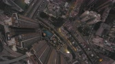 tilted : Hong Kong Aerial v195 Flying over Kowloon City looking down vertically at dusk