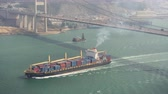 vessel traffic : Hong Kong Aerial v219 Flying low around Tsing Ma Bridge with cargo ship passing by 217 Stock Footage